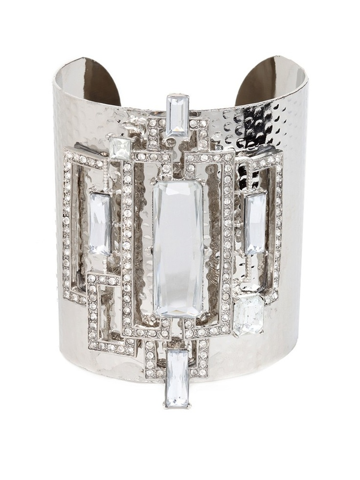 Geometric sparkle is the cornerstone of this deco-inspired cuff.  We think the mix of bold silver and jaw-dropping graphic crystals would be enough to make Daisy Buchanan blush.  This is part of the ELLE Holiday Shop