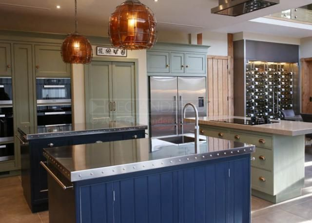GEC Anderson's brushed satin stainless steel worktops with integrated sinks, featured in a Turnen & Fox luxury kitchen.  High durability with a resilience to heat, fire and sustained heavy use; Totally hygienic composition; Minimal maintenance; Low lifetime costs; 100% recyclability