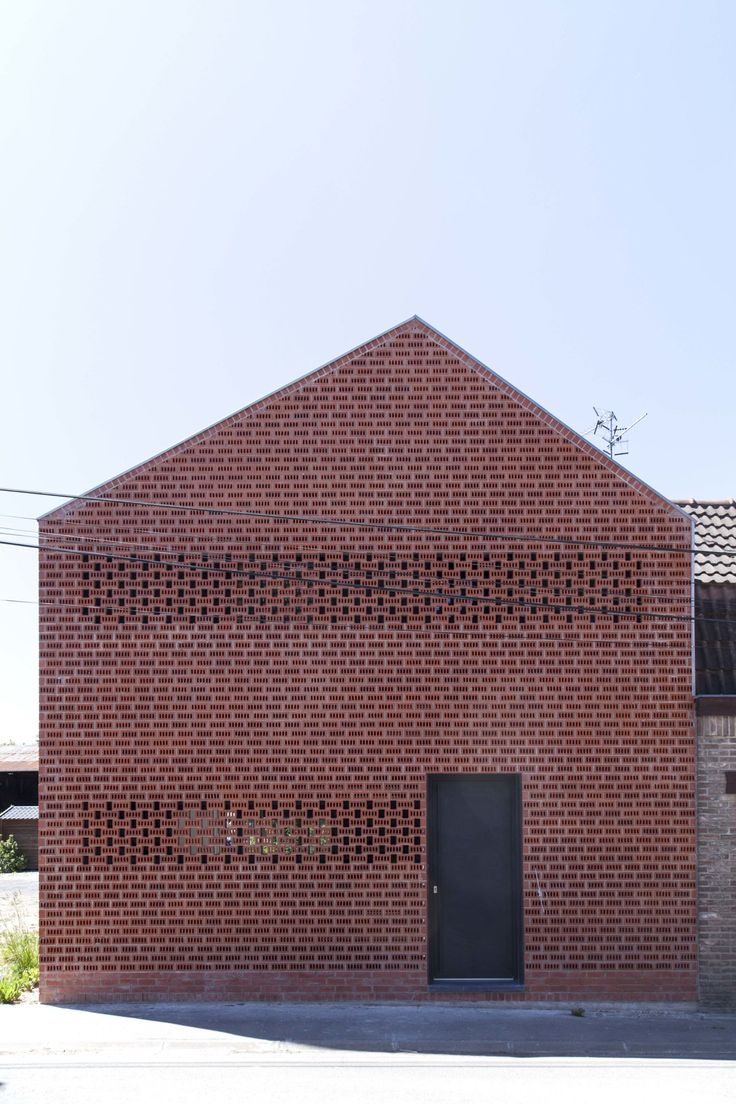 Yoda Architecture pairs perforated brick with corrugated iron for a rural French home