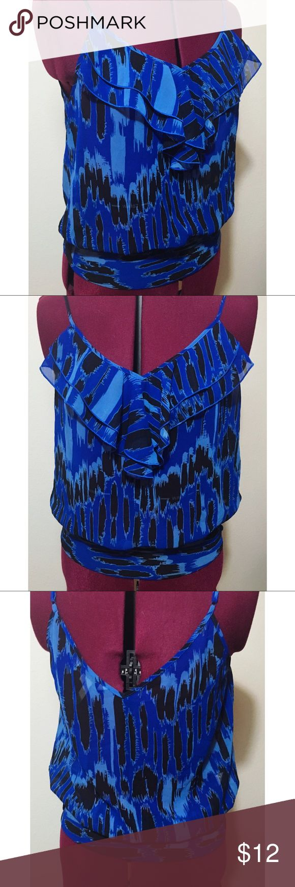 "Sleeveless Blouse by BCBGeneration Man made silk, v-neck line, ruffle accents. Blue color with a fun print. Adjustable straps. Slightly loose fit. Size S, but this brand tends to run big! Chest measurement is 30"". Great condition! BCBGeneration Tops Blouses"