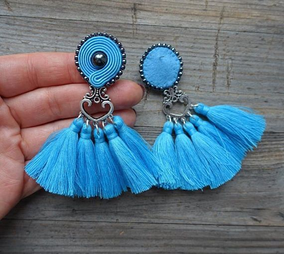 Earrings made in soutache embroidery technique. The color of dark blue and silver. Material: hematite, toho beads, hand made tassels, decorative elements; Earrings length 8 cm (with earwire) 3.1 inch Finished with black felt. Impregnated. If you have a question, write to me :) ------------------------------------------------------------ I invite you to watch my other works :) https://www.etsy.com/shop/MrOsOutache?ref=pr_shop_more