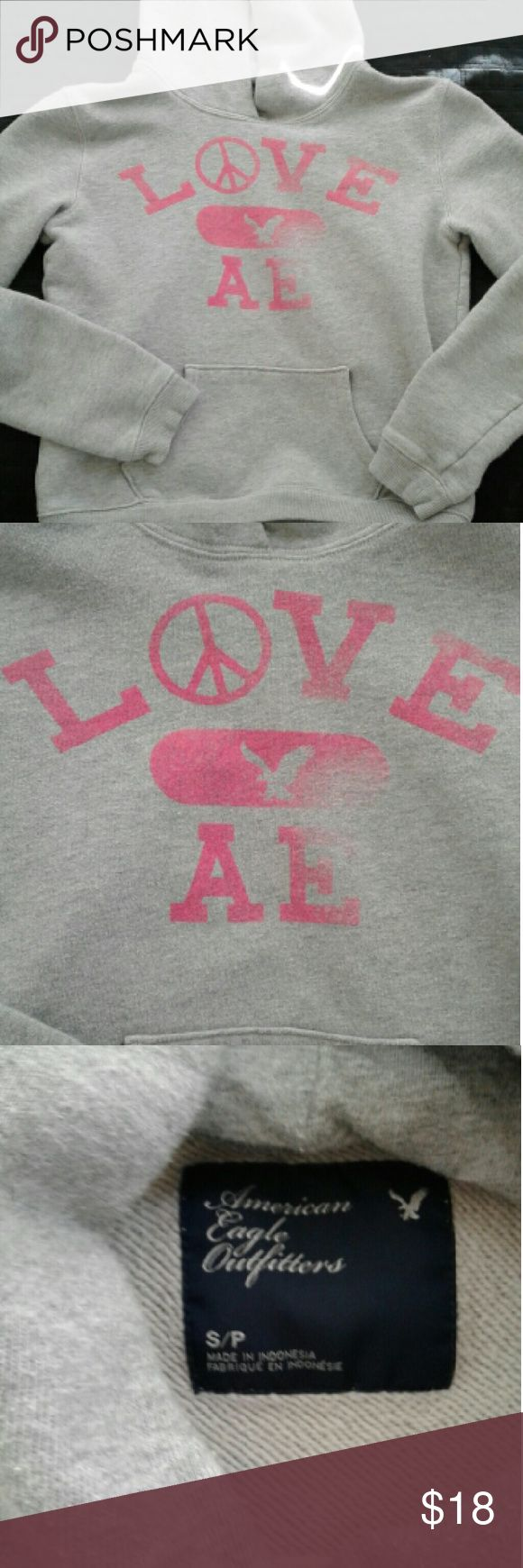 American Eagle hoodie American Eagle hoodie with pink writing on the front. Comfortable and cozy terry cloth inside. American Eagle Outfitters Tops Sweatshirts & Hoodies