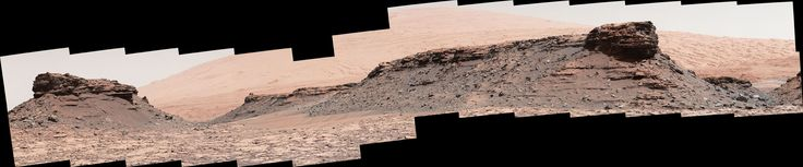 Martian Mesas in 'Murray Buttes' Area, Sol 1434 The two prominent mesas in this view of Mars' 'Murray Buttes' region from NASA's Curiosity Mars rover are about 260 feet (about 80 meters) apart. Upper Mount Sharp is the salmon-hued mound dominating the horizon between the scene's two prominent mesas.
