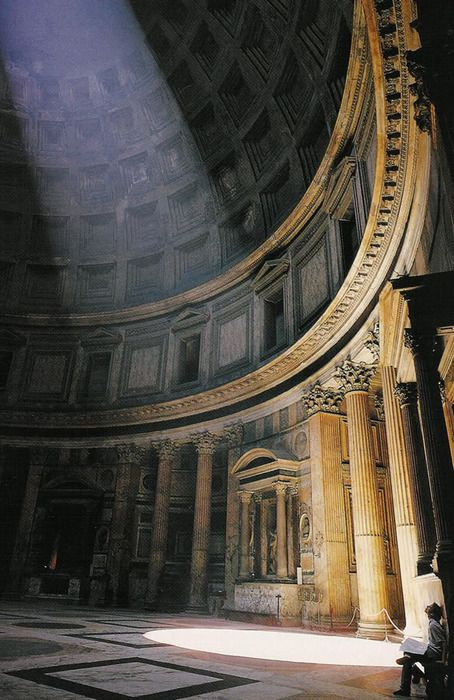 Interior of the Pantheon, an ancient Roman temple built in honor of Roman gods. Constructed of concrete, it features a large dome with an oculus of 43.3 meters (142 ft) in diameter