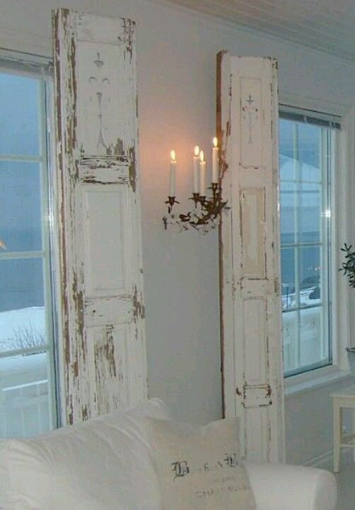 Repurposed vintage painted shutters instead of drapes.  Upcycle, Recycle, Salvage!  For ideas and goods shop at Estate ReSale  ReDesign, Bonita Springs, FL