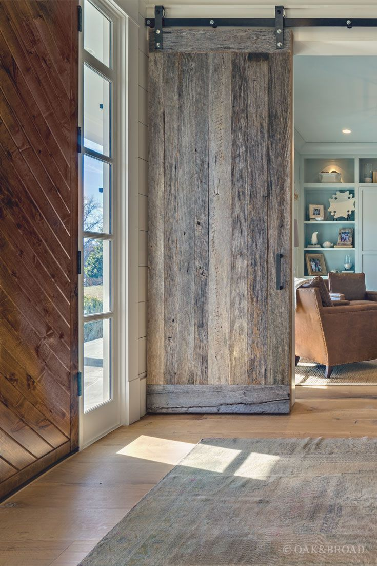 #WidePlank #WhiteOak #HardwoodFloor By Oak And Broad With Custom Stain | Entryway With Eclectic Reclaimed Style Wood Barn Doors In Rustic Modern Tennessee Home | Discover more at http://OakAndBroad.com/nashville-tennessee-wide-plank-white-oak-flooring/