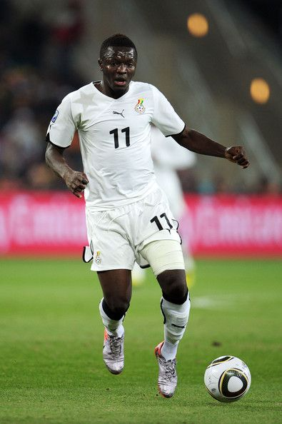 Sulley Muntari Photos Photos - Sulley Muntari of Ghana in action during the 2010 FIFA World Cup South Africa Group D match between Ghana and Germany at Soccer City Stadium on June 23, 2010 in Johannesburg, South Africa. - Ghana v Germany: Group D - 2010 FIFA World Cup