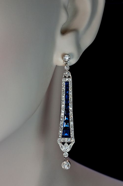 Art Deco sapphire and diamond pendant dangle earrings,   Art Deco Sapphire and Diamond Dangle Earrings  1920s  Finely crafted 18K white gold vintage earrings are channel set with calibre cut blue sapphires (estimated total weight 3 carats)  and bright white old cut diamonds (old European and old single cuts).   The estimated total diamond weight is 3 carats. Color range F-G, clarity range VS2-SI2.  Length 60 mm (2 1/4 in.)