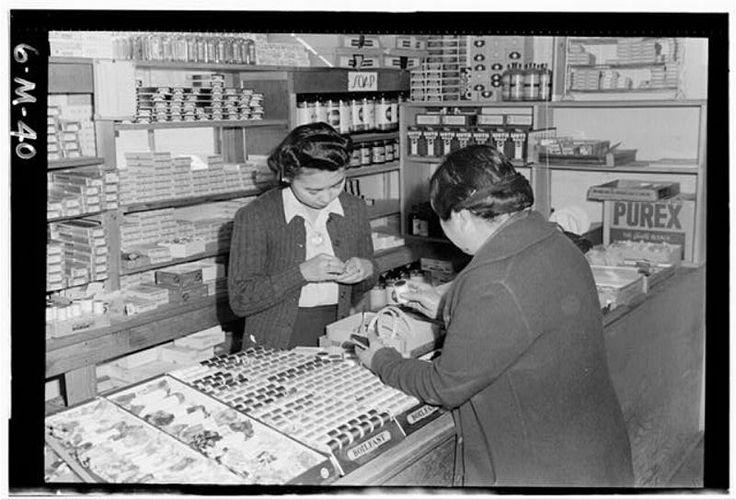 Manzanar Cooperative Store, Masako Suzuki by Ansel Adams