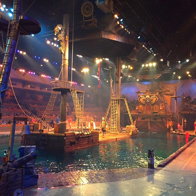 Pirates Voyage Dinner and Show, Myrtle Beach, South Carolina - Experience the swashbuckling excitement as Crimson and Sapphire pirates battle each other on deck, in the water and sky above on their full size pirate ships in a 15 foot deep lagoon. Plus live animals, spectacular acrobatics, all while you enjoy a fabulous 4 course pirate feast. (Photo via Instagram by @michelle_8874  - click on the pin for additional shows in the Myrtle Beach area)