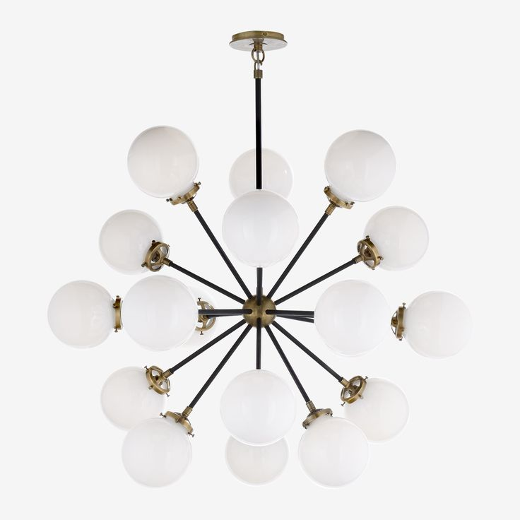 The Bistro Round Chandelier in Hand-Rubbed Antique Brass with White Glass by Ian K. Fowler  The spectacular 18 light hanging chandelier designed by Ian K. Fowler • A perfect blend of form and function, the Bistro makes its mark with its irregularity and then nails it with its stunning finishes and surprising beauty. These finishes make it a perfect match for an array of home interior styles and work just as well in a commercial environment.