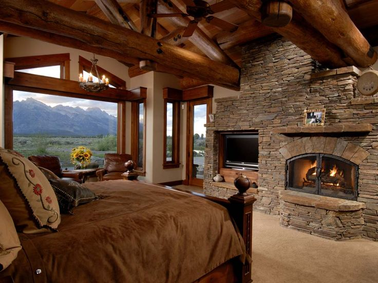 Log cabin master bedroom fireplace so relaxing dream for Cabin fireplace pictures