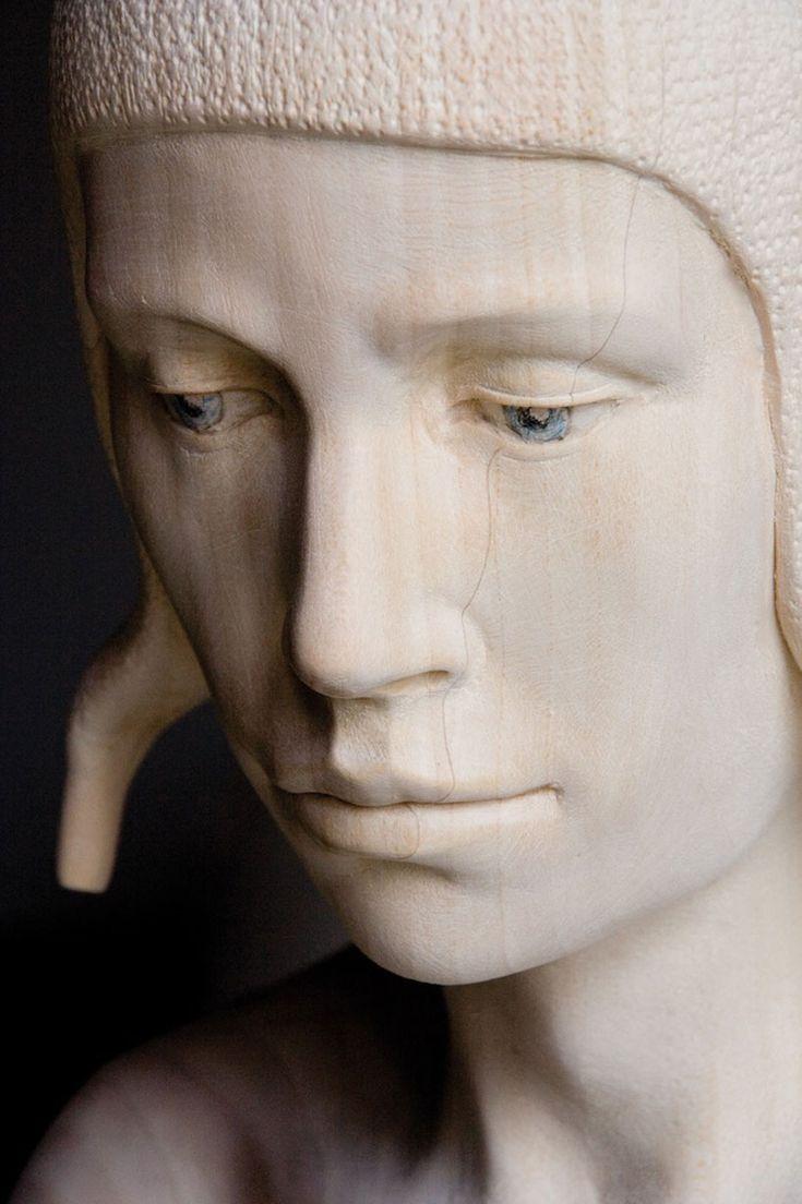 mario dilitz: lifesize wooden sculptures bear human emotion