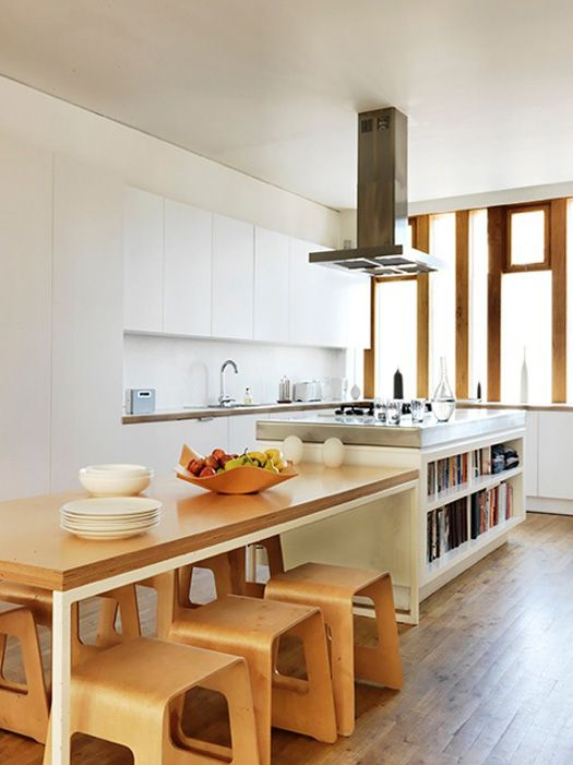 love the idea of a table connected to an island. great look for a long narrow space that must include kitchen and eating area.