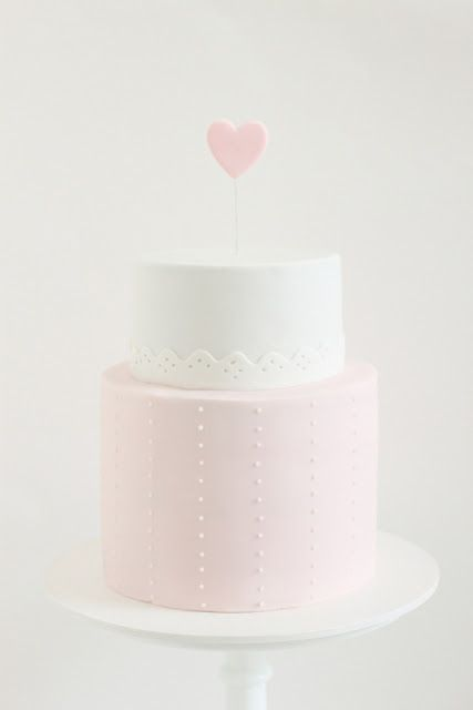 sweet simple cake with heart topper