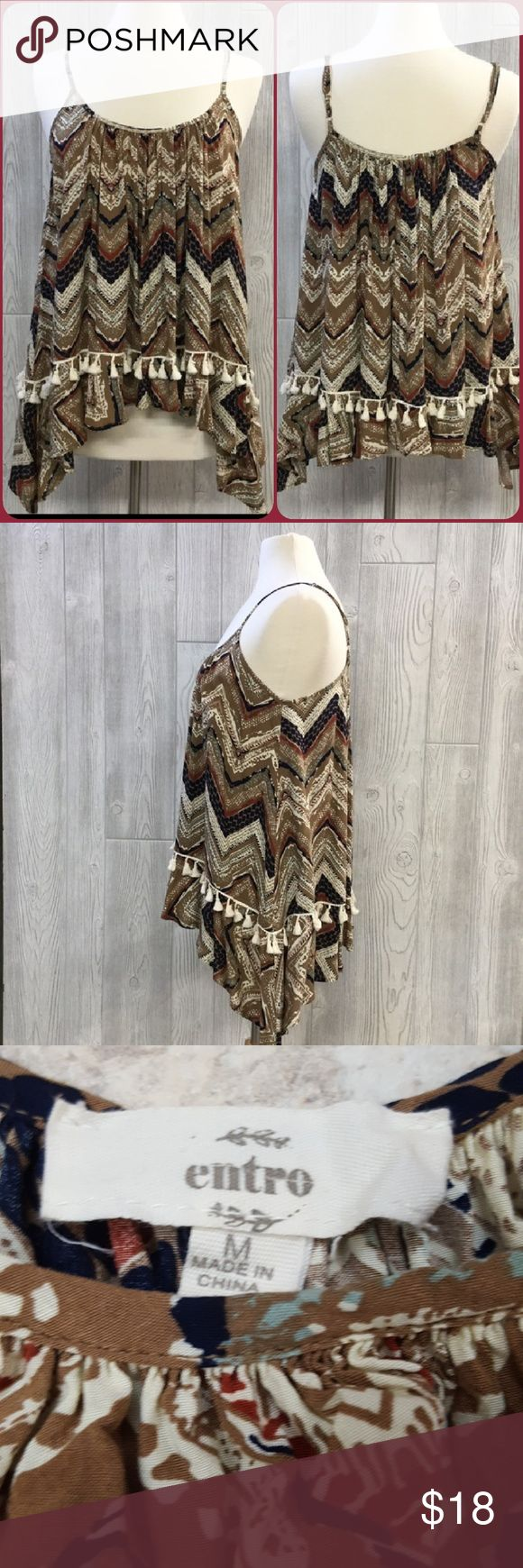 """⚘New! Hanky hem tribal tank with tassels ❤💙❤ this but I just don't find myself reaching for it so has to go. Worn once and in pristine condition. Adjustable straps, loose and flowy. Length is 25"""" at the shortest points.  Lots of coordinating colors...would be super cute with mint capris and a neutral wedge. Toss on a denim jacket or corduroy blazer when it gets chilly. 100% rayon. Entro Tops Tank Tops"""
