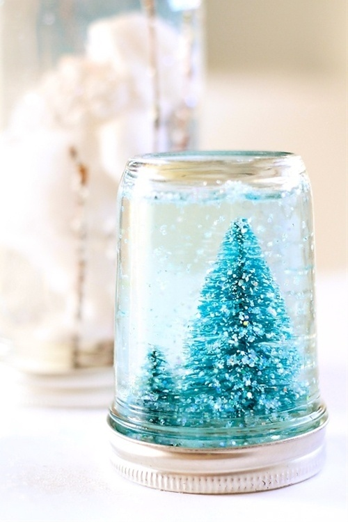 I like the concept of a DIY snow globe but maybe with something wedding related!!