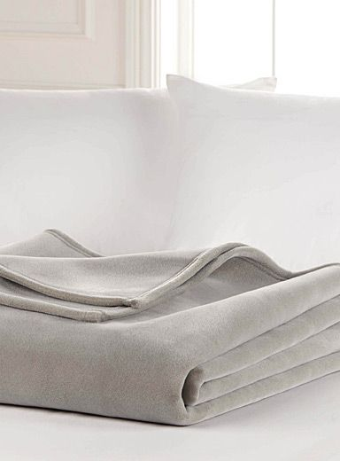 """Exclusively from Simons Maison     Light and durable nylon throw with an ultrasoft velvet sponge texture. Easy-care, machine washable.      Dimensions   Twin: 66"""" x 90""""  Double: 84"""" x 90""""  Queen: 90"""" x 90""""  King: 108"""" x 90"""""""