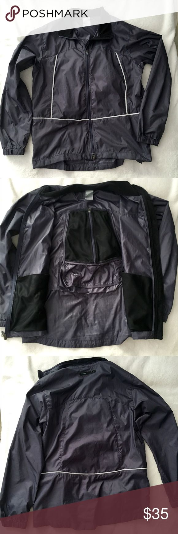 Nike Running Jacket Size Medium wind jacket. Has multiple different pockets and reflectors. Darker gray in color. Nike Jackets & Coats