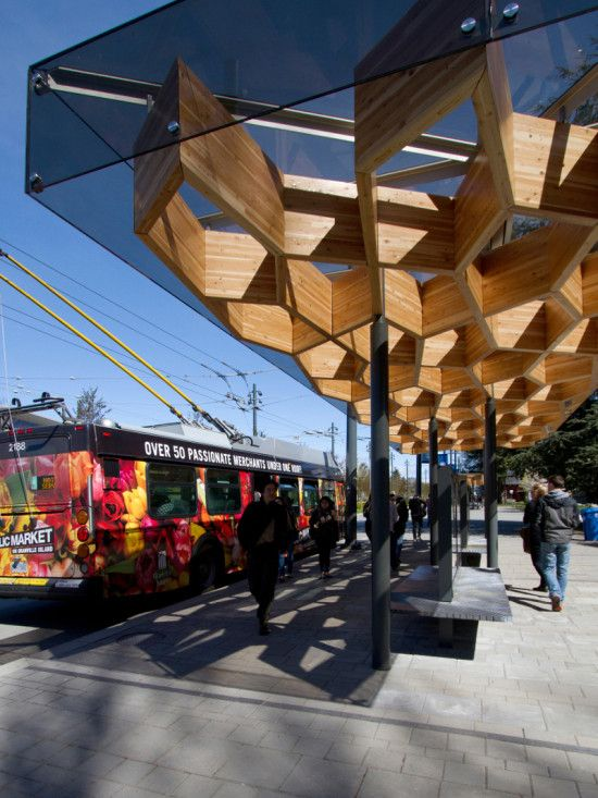 THE GLULAM CANOPY FEATURES A PATTERN OF REPEATED IRREGULAR PENTAGONS (PUBLIC: ARCHITECTURE + COMMUNICATION)