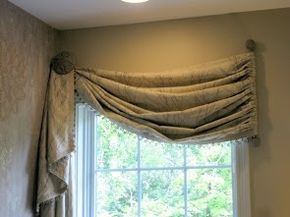 window dressing use a small decorator rod hung vertically at winbdows frame edge single tie back to create valance