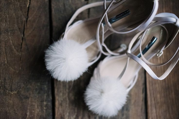 Ivory sandals with pom poms. Photography by Claudia Rose Carter