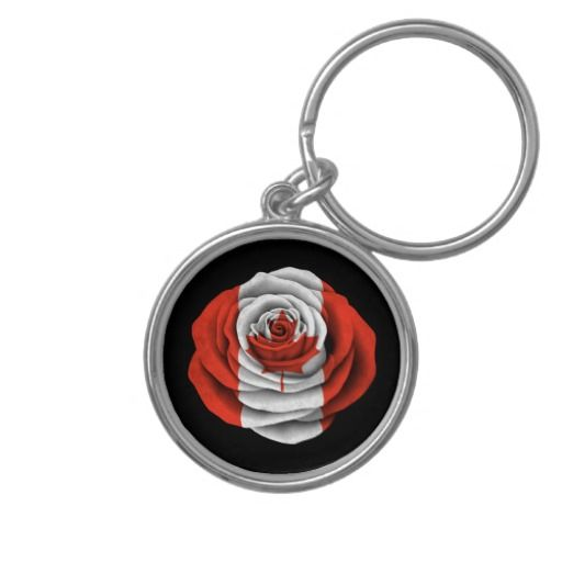 Canadian Rose Flag on Black Keychain. This unique pattern features the flag of Canada painted onto an open rose. The delicate layered flower pedals spread out from the tight center to form a circular design. This beautiful Canadian pattern is a perfect combination of patriotism and love of nature.