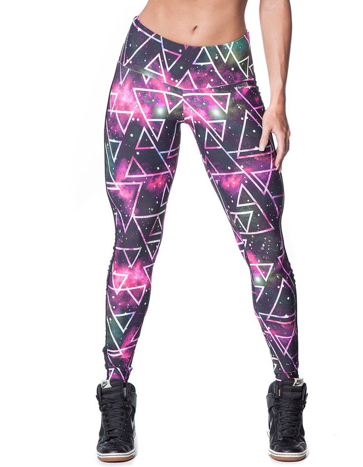 These leggings are from the new 2015 Space Collection. These leggings feature geometric shapes on a space background and black ruffle detail down the sides of the legs. The waistband is wide and designed to sit smoothly against the waist.