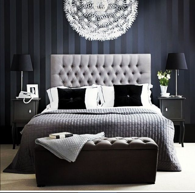 Neat elegant bedroom decor in navy and gray