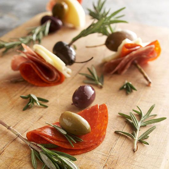 Olive-Pepperoni Kabobs Spear a sliver of cheese, a slice of pepperoni, and a whole Italian olive on a rosemary sprig to create a delightful party morsel. Presentation is so important @DinnerByDesign