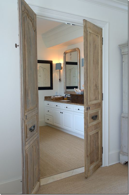 Set of antique doors that lead into the master bath - love the architectural interest it adds to the room and so unexpected!
