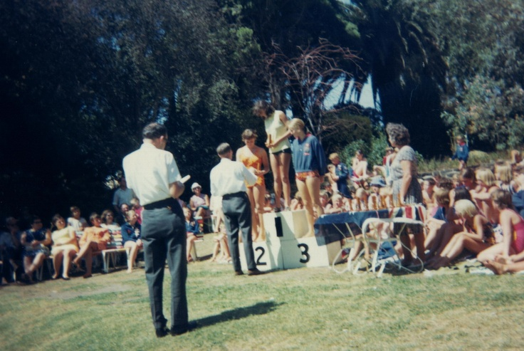 Andrea Cooper receiving award for 1st place at Malvern Baths, 1968.
