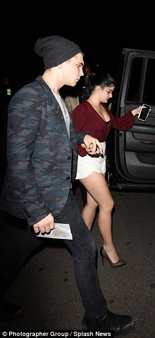 Stepping out: Ariel teamed the daring maroon sweater with a risque pair of white hotpants,...
