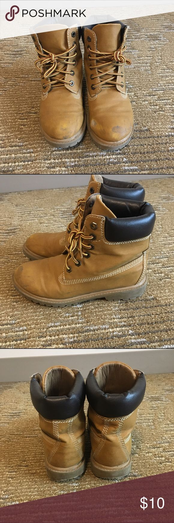 Timberland style boots by ESPIRIT Worn out in the snow and rain which explains the scuffs, but they are very sturdy and also cute to wear! This is technically a size 6, however it runs pretty big. Fits like a 7-7.5 Shoes Combat & Moto Boots