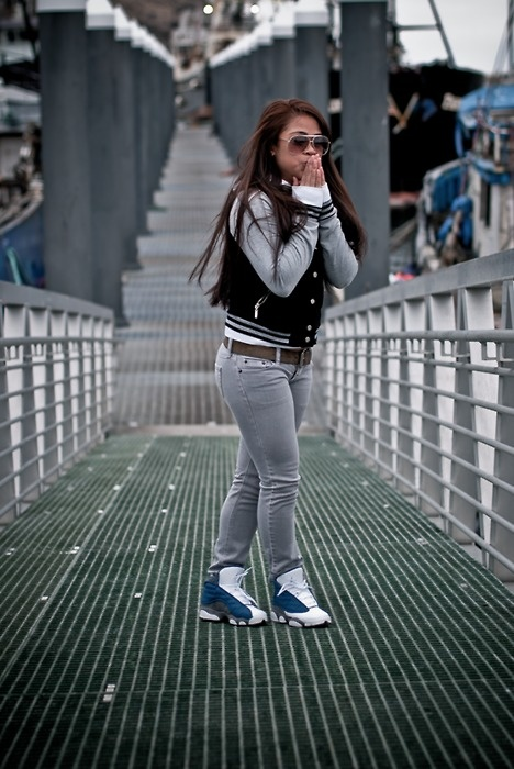 ★ ★ ★ ★ ★ five stars (black and grey varsity jacket, white long sleeve, brown belt, grey skinny jeans, blue and white sneakers, brown aviator sunglasses)