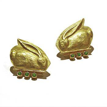 Sleeping Bunnies by Linda Kindler Priest. Earrings in 14k gold, with 36pt tsavorites. Approx 1 x 1
