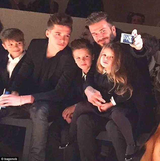 Fun for all: (From left to right) Romeo, Brooklyn, Cruz, Harper and David were taking endless pictures at their mother's Fall/Winter 2015 catwalk show