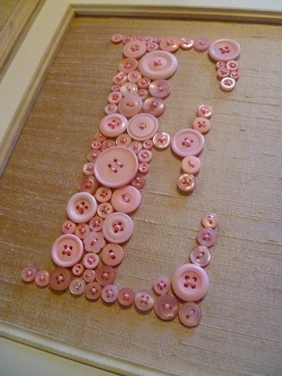 MAKE - BUTTON TYPOGRAPHY ART:  shades of  baby pink buttons sewn onto ecru silk fabric and then framed.