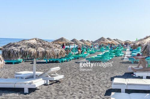 Santorini, Greece - June 20, 2016: Black sand beach of... #perissa: Santorini, Greece - June 20, 2016: Black sand beach of… #perissa