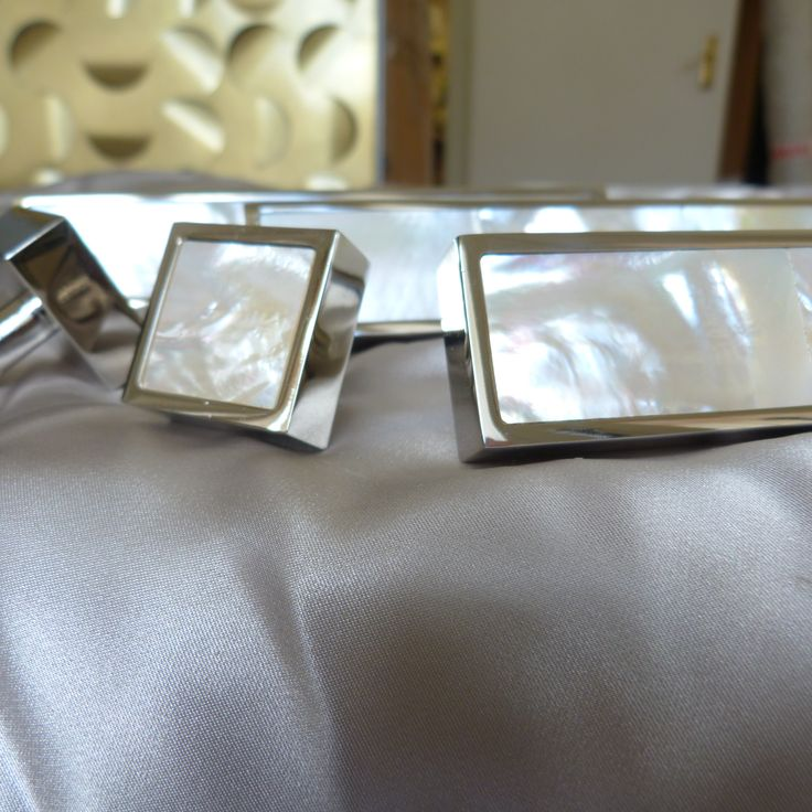 Cabinet handles in polished nickel finish with white Mother off Pearl insert. Made to order.