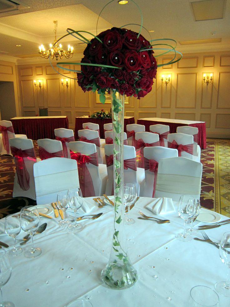 Lily vase display wedding flowers red burgundy