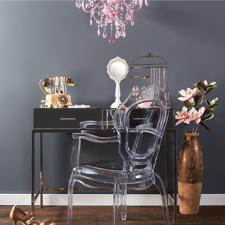The Aimee Dining Chair is a modern take on a classical silhouette. Made from polycarbonate, this airy dining chair is sturdy, light weight, and stackable. Easily at home with a dining table or desk. The Aimee Dining Chair is sure to give your space a touch of glamour. -