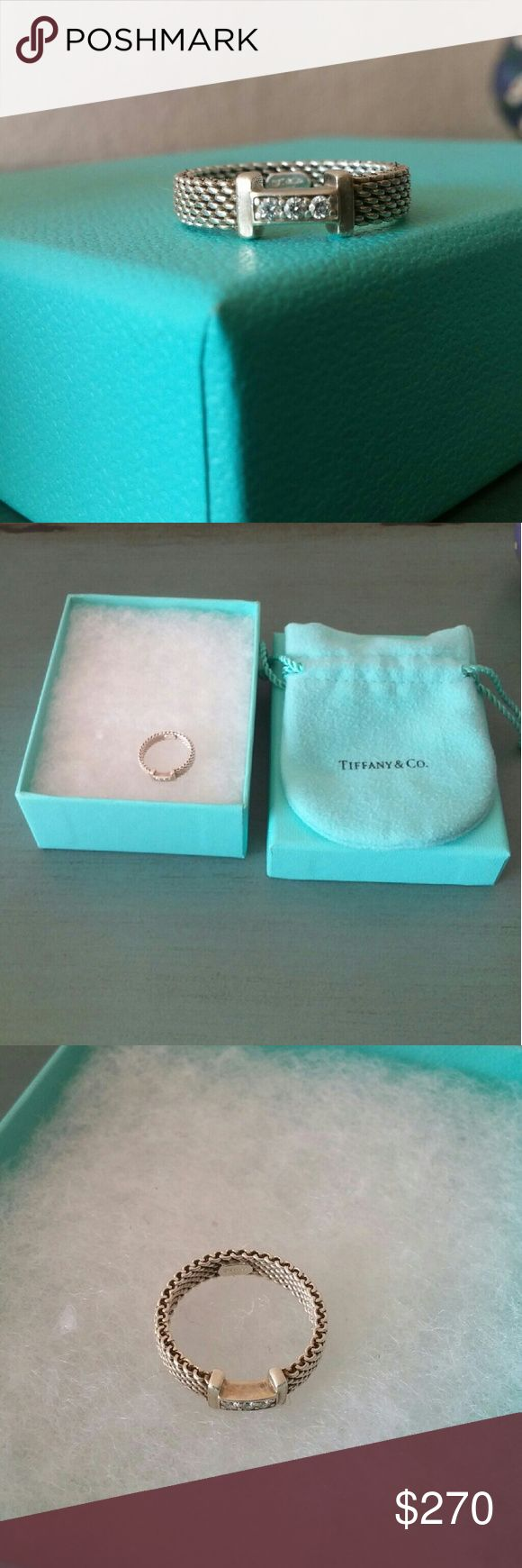 Tiffany & Co. 4 3/4 silver diamond ring Authentic Tifanny ring . Silver 925 3 round diamonds full cut  0.04 ct. As you can see in the picture there is a bit of black on the smooth silver part. Iv never had it cleaned, its been put away and I don't use it.  Its not new so its not going to look new.  Its never been resized. I have the box and pouch. Its still being sold on Tiffany & Co. Website for 575. Tiffany & Co. Jewelry Rings