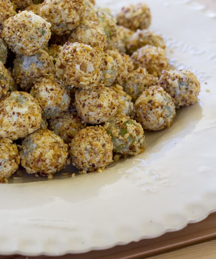 Goat's balls snacks: grapes rolled in goat's cheese and nuts.