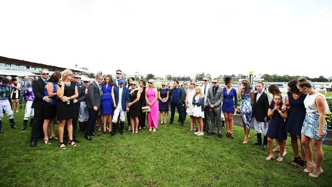 Friends and family reflect during a one minute's silence requested by Tommy. The grief and sorrow was overwhelming for many. The group, all wearing blue, huddled by the track, some sobbing, others only just holding it together. And in those moments the racing industry, so often divided, was well and truly a family.