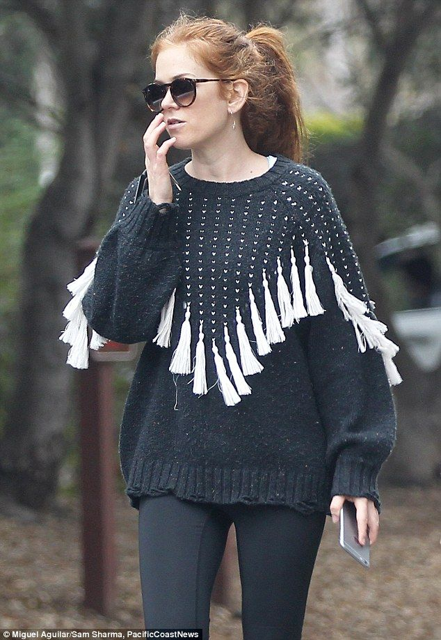 Eye catching:The Australian actress was hard to miss in a fringed sweater during the earl...
