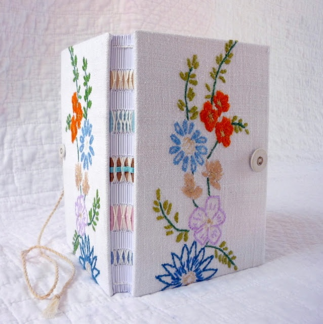OOoooh. Embroidery like my birdcage journal, but with spine sewing to match. And embroidery looks bookbinder-made. So soft and sweet.