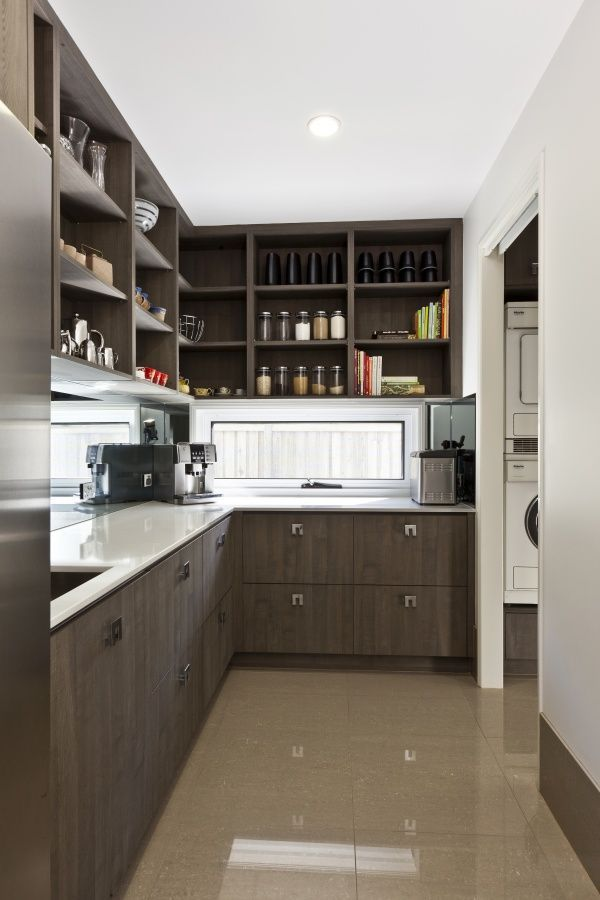 I do not favor the modern look of this pantry, but it has all the functional elements: sink, counter top, open shelving, under counter cabs/drawers