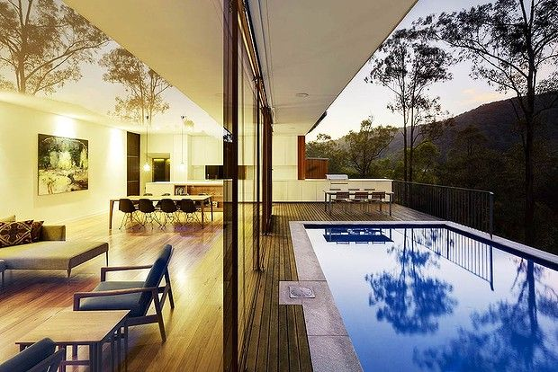 Thin lines... architect Rory Brooks used the clarity of glass and blackbutt-clad timber to blend the house into its Sydney bush setting. Photo by Michael Nicholson