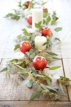 simple friendsgiving centerpiece with eucalyptus, apples, candles.